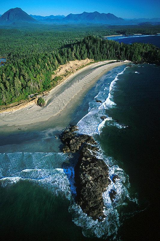 Crystal blue ocean waters along sandy beach