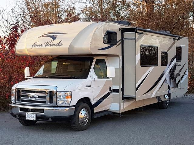 Ambassador RV 28' tan color with red fall leave background