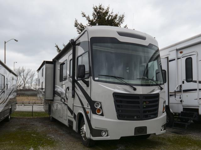 Outdoor Travel 32' white Class A in parking lot