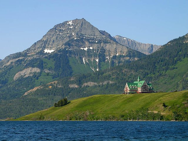 majestic hotel with green roof over looking Waterton Lake