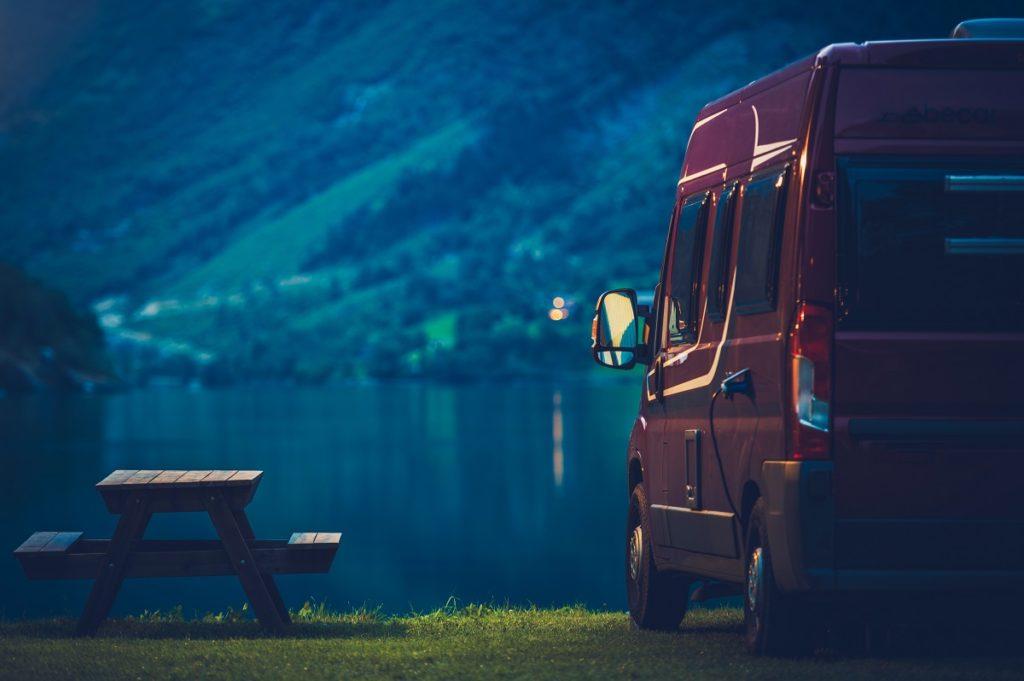 RV Camping at Night. Small Camper Van